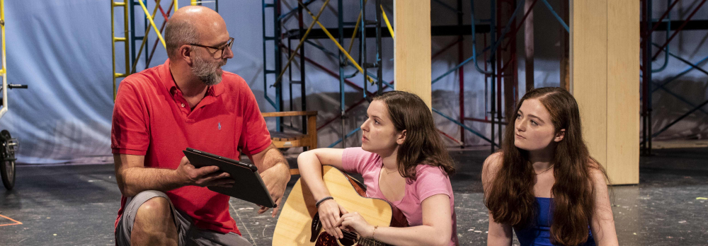 David Roth working with students during the summer production of BACK TO THE 80's.